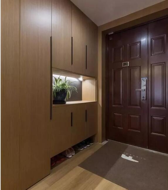 三居室112平米现代木色三室1